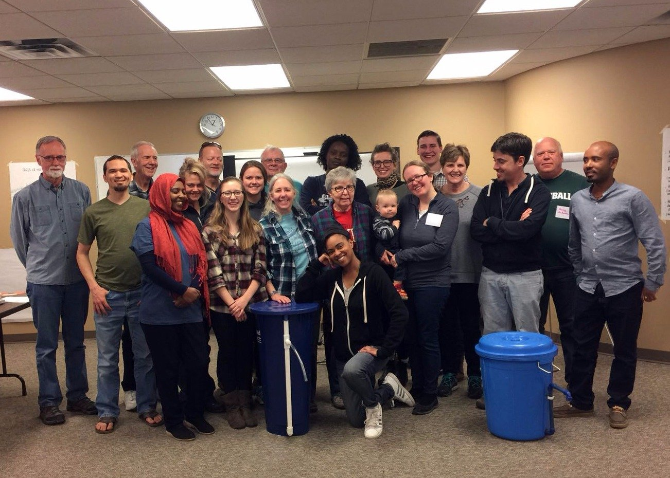 The volunteers, board members, trainers, and graduating class of AVFCW's 2018 Water Workshop.