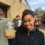 A student holds up a glass of dirty water, before we put it through the filter.