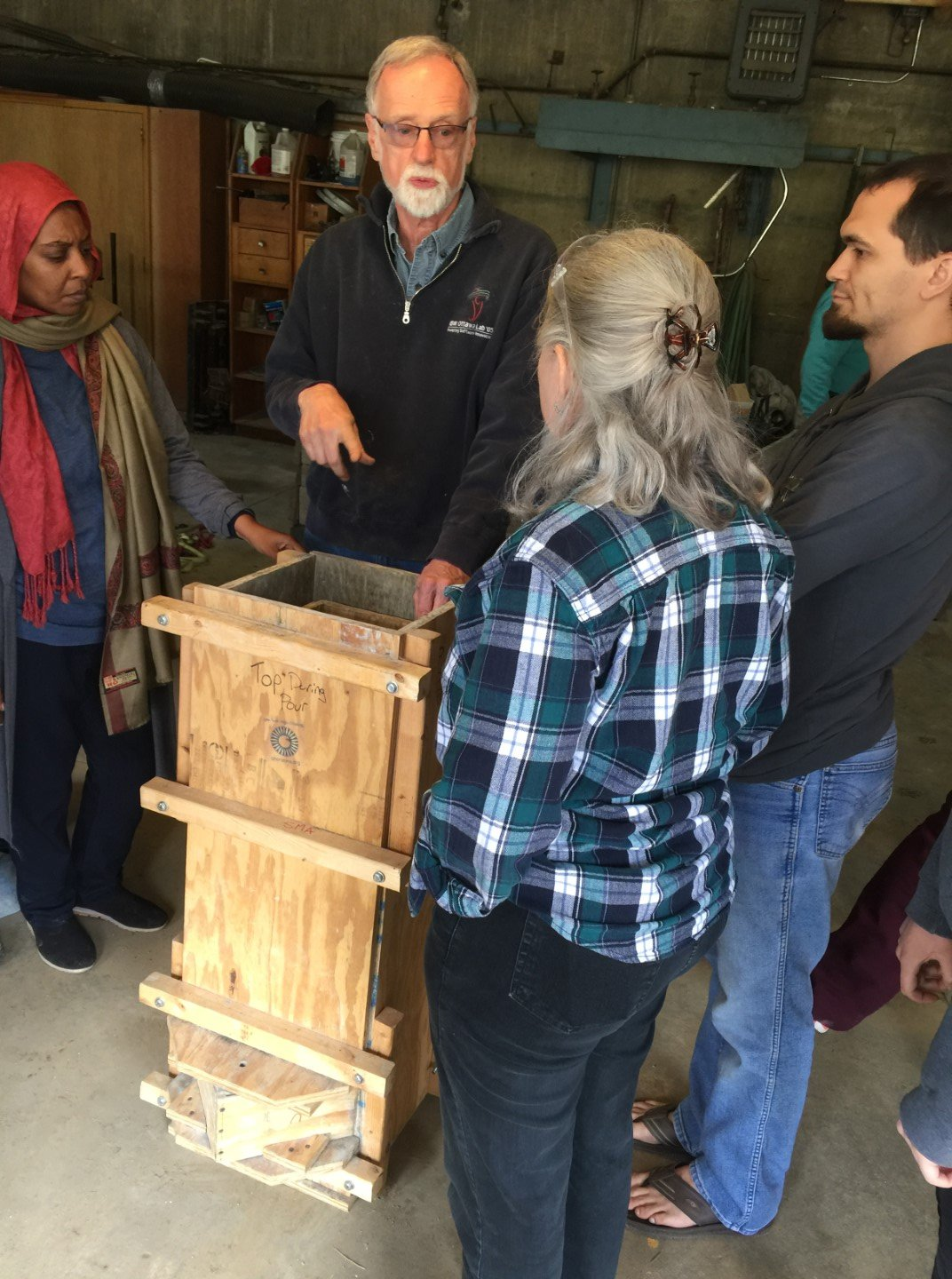 AVFCW Board Member Peter teaches students about an alternative, wooden, water filter mold.